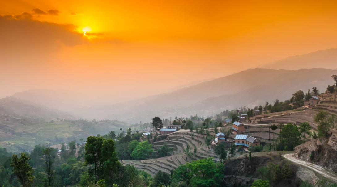 Travellers watch the sunset over the Himalayan Mountains in Nagarkot, Nepal.